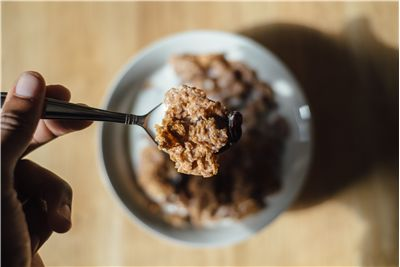 Picture Of Spoon Of Breakfast Cereals With Milk